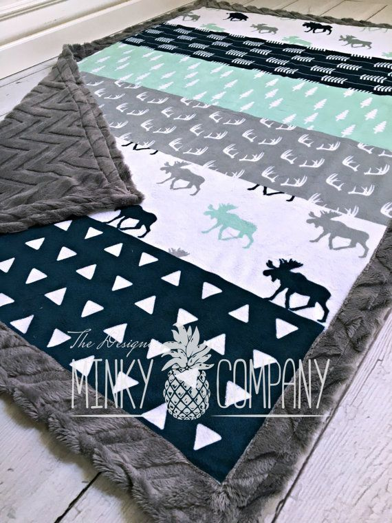 Perfect for boy or girl! This blanket has minky on both sides. The front side is one solid piece of designer minky (the top is one solid piece of minky that has not been cut or quilted). It has strips of moose, triangles, arrows, and antlers in navy, mint, white and grey. The back and boarder are your choice of greyl minky. ●▬▬▬▬▬▬▬♥ Size and Fabric Options♥▬▬▬▬▬▬▬●  ★ Please select from the drop down menu which fabric you would like for the back and boarder.  ★This blanket is available in…