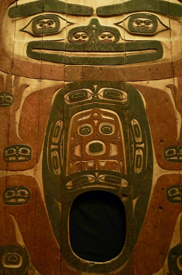 about 1840 Tlingit house partition (currently at the Denver Art Museum). Designed as a doorway between rooms (that's right, you climb right into her belly, or, um, maybe it's her, you know), this house partition features a fantastical multilayered being with faces set into her joints, eyes, nostrils, & pelvis. The decorative & symbolic power beats almost anything I've seen done with a doorway before.