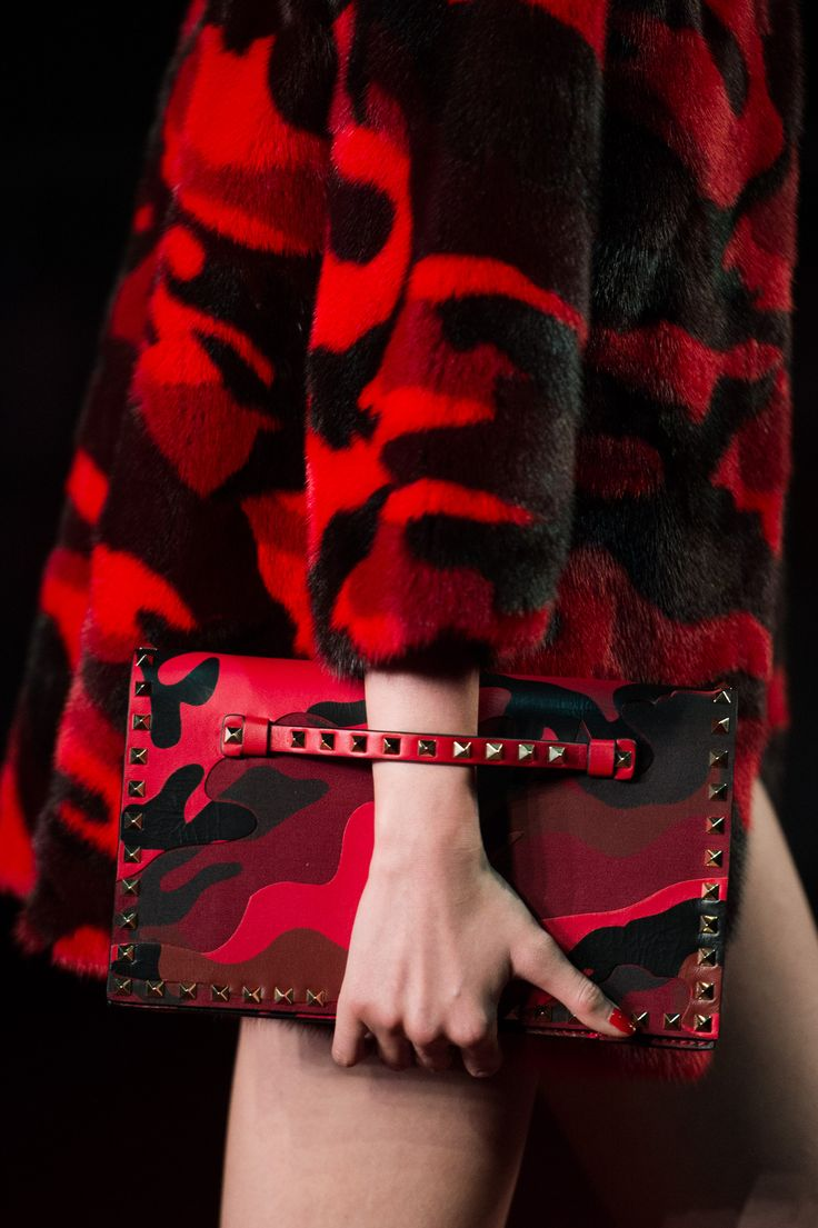 THIS: red camo ponyhair studded clutch. if anyone other than valentino did this, it would be awful. But it's AMAZING.