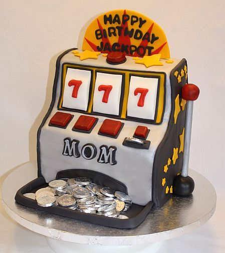 A Slot Machine Cake will make a great birthday surprise. See images of great looking fruit machine cake designs. Learn how to make a slot machine cake.