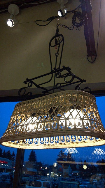 Antique Baby Buggy -- converted into two light chandelier. For sale at Common…
