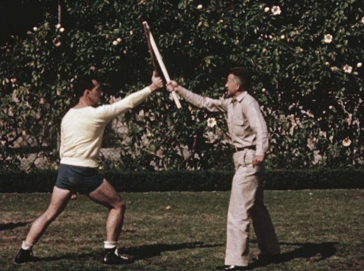 Police training film demonstrating the use of a baton, 1958. Dramatization on Weller Street (later renamed Astronaut Ellison S. Onizuka Street), Little Tokyo, Los Angeles, California. Training at the Los Angeles Police Academy, 1880 Academy Drive.