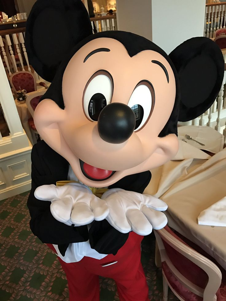 Mickey striking a blow kiss pose