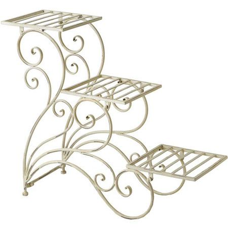 Display your favorite greenery, blooms, and herbs with this charming iron plant stand, showcasing a white finish and scrolling design.