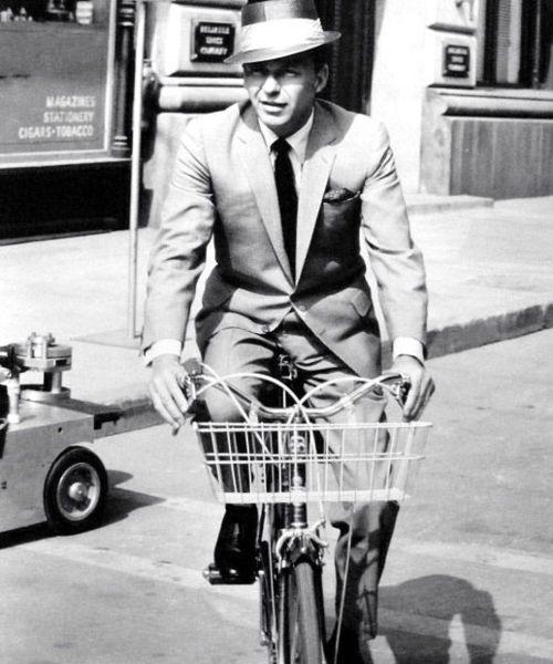 Frank Sinatra rides a bike. 1963
