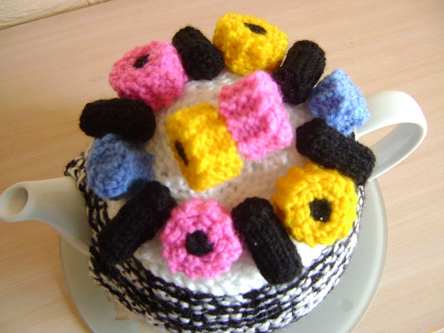 knitted tea cosy with liquorice sweets by jacksknits