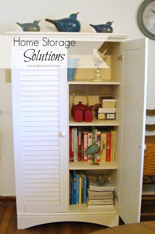 Home Storage Solutions using a storage cabinet from Sauder Woodworking Company. Love that this cabinet has doors to hide clutter! #sponsored #organization #storagesolutions