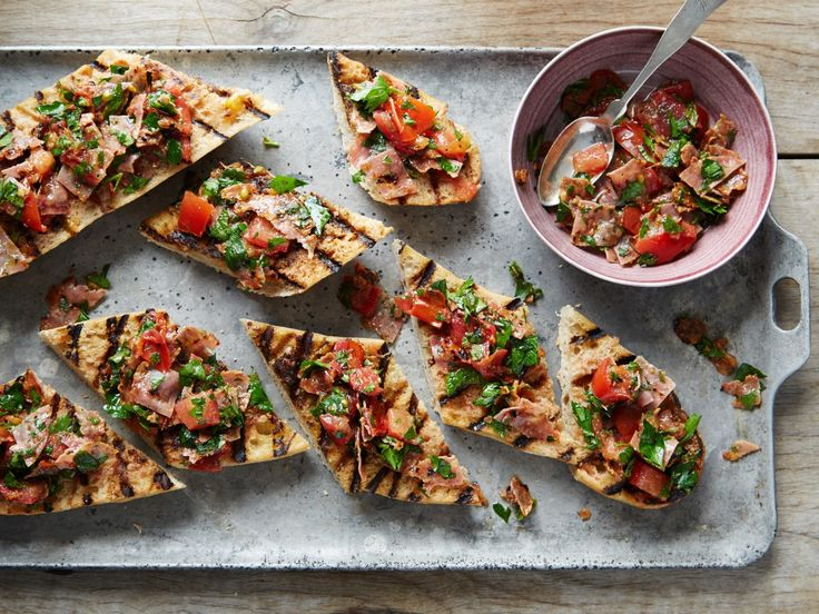Just a little bit of meat goes a long way in this twist on the classic Spanish Pan Con Tomate (which simply means bread with tomato).