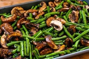 Yum!! Roasted green beans with mushrooms, balsamic, and Parmesan. Marinate in ziploc bag, spread out on cookie sheet and bake at 400, then sprinkle with Parmesan. Could do this with fresh asparagus too...yum!.