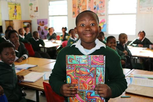 """Grade 4 pupils spent their """"67 Minutes"""" on Madiba Day covering and decorating books for pupils at Sophakama Primary."""