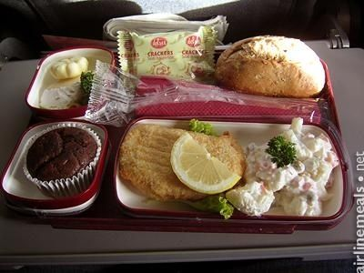 Nuremberg To Monastir Chicken Kiev with cauliflower salad. Warm roll. Salted crackers. Chocolate muffin.