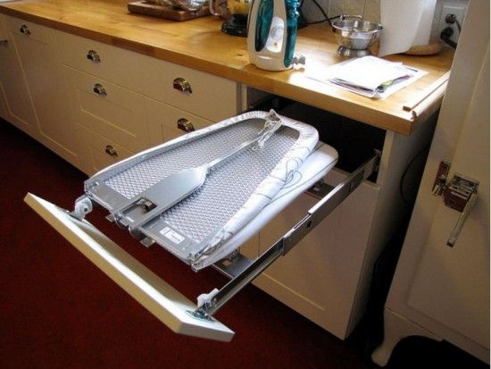 Built-in ironing board in kitchen/laundry, this fixture is from IKEA. Of course it is!