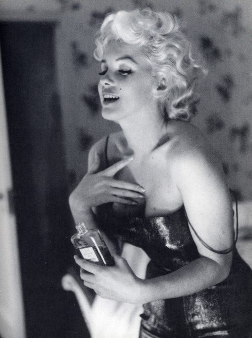 I have this huge portrait in my room! Black and White Marilyn Monroe Chanel No. 5.