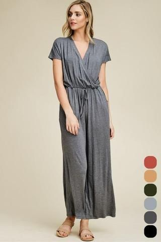 55e4fb2aa503 A Solid Knit Gray Jumpsuit featuring a Scoop Neck