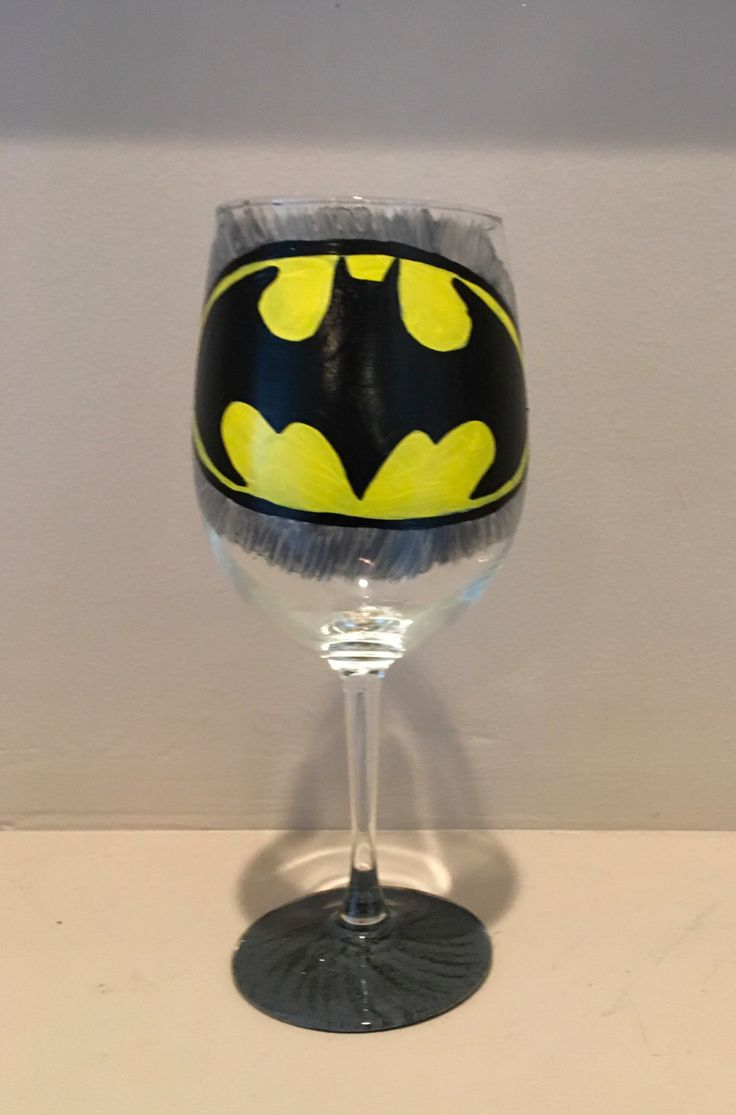 A personal favorite from my Etsy shop https://www.etsy.com/listing/484719912/hand-painted-batman-wine-glass
