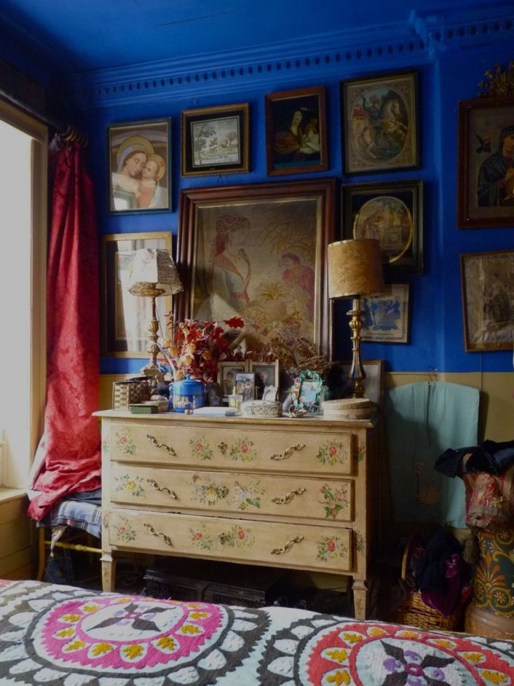 Colbalt or electic blue walls/ Bedroom// Hand painted chest. Red damask curtains.
