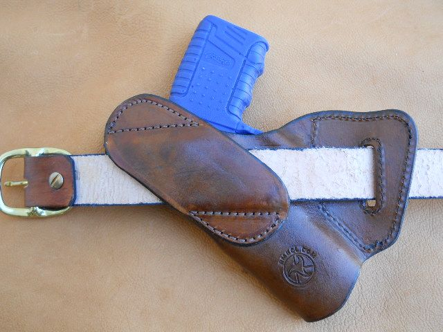 Small of Back Leather holster for Tim - this details how the back looks and operates.