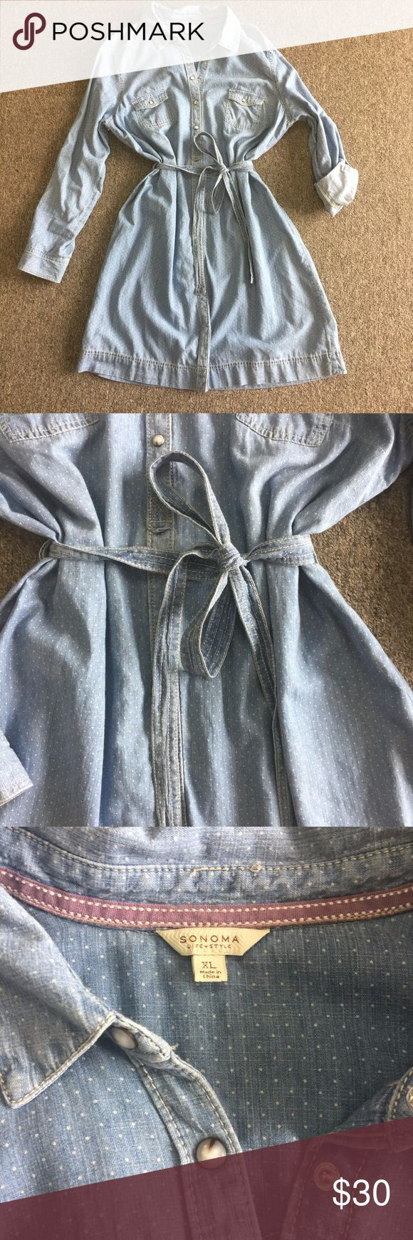 """Sonoma Chambray Dress   Size XL Chambray shirtdress from Sonoma at Kohl's. Denim with small white dots allover. Dress is in excellent condition, with no signs of wear, no holes, stains, or other imperfections. Dress has a collared neck and buttons down the front. Long sleeves with cute little white buttons can be worn down or rolled up. Ties at waist. Size XL measurements laid flat: B: 23"""" W: 23"""" H: 23"""" L: 39"""" from shoulder seam to bottom hem. Sonoma Dresses"""
