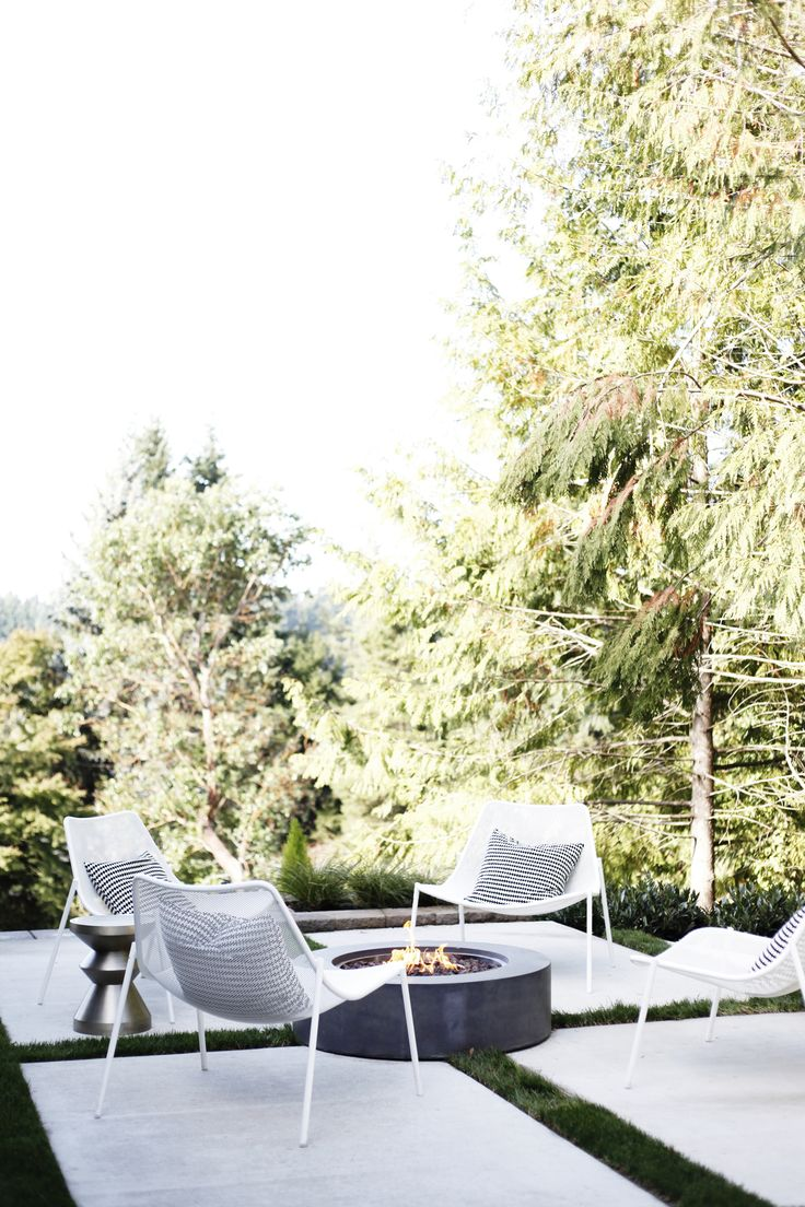 Scandinavian, modern, midcentury outdoor space.  Fire table, Room & Board outdoor lounge chair