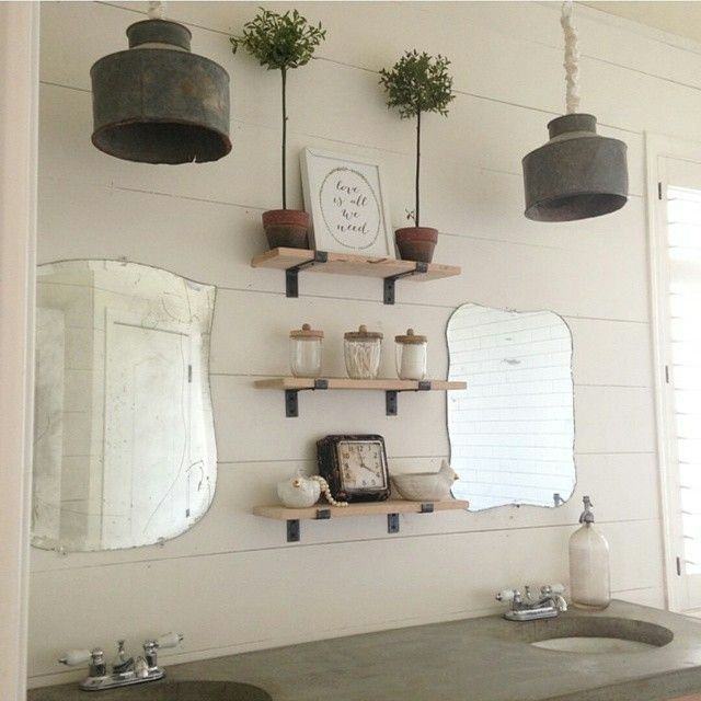 Nice modern farmhouse style bathroom mixes rustic shiplap with repurposed industrial lighting
