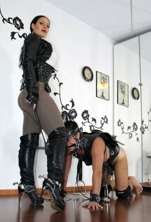 Two hot femdoms punishing a submissive guy
