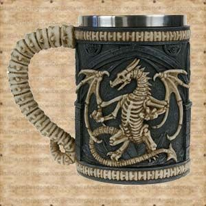 A dragon skeleton on a gothic castle design covers this tankard and the handle has the appearance of spine bones. This dragon tankard has a removable stainless steel insert for ease of cleaning measuring approximately 12.5cms deep with a diameter of 8cms. The Dragon Remains Tankard brought to the Skulls and Dragons drinkware range by Nemesis Now.    Height : 14 cm    Width : 10 cm    Length : 16 cm    Weight : 650.00g    Made from resin, stainless steel    Was £18.99 Now Only £9.50