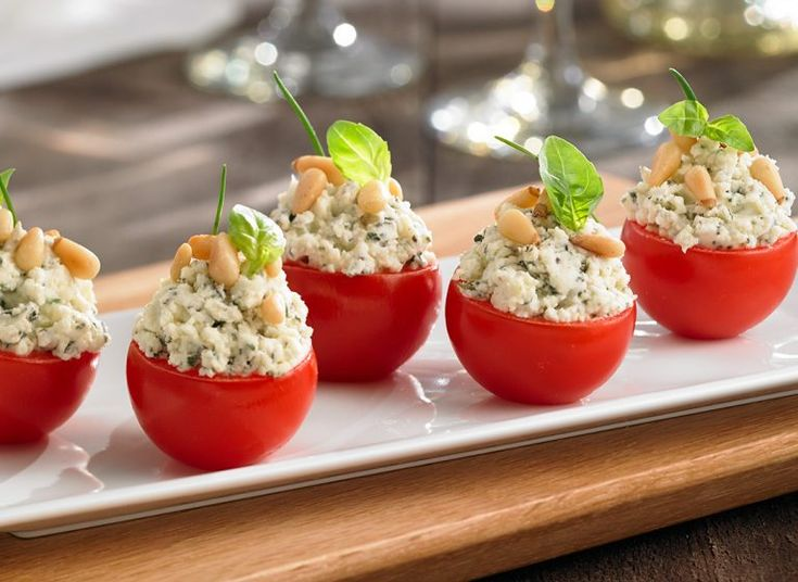 Cherry tomatoes stuffed with  Boursin® and toasted pine nuts