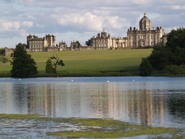 North front of Castle Howard across great lake. In 1952, the house was opened to the public by then owner, George Howard, Baron Howard of Henderskelfe. It is currently owned by his son, the Honourable Simon Howard, who grew up at the castle.
