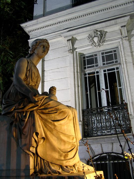 Thessaloniki, A statue outside the State Conservatoire of Thessaloniki. The building which now houses the Conservatoire was built at about 1903. What does the statue representt? A Muse would be an appropriate option! Night shot, without a flash.