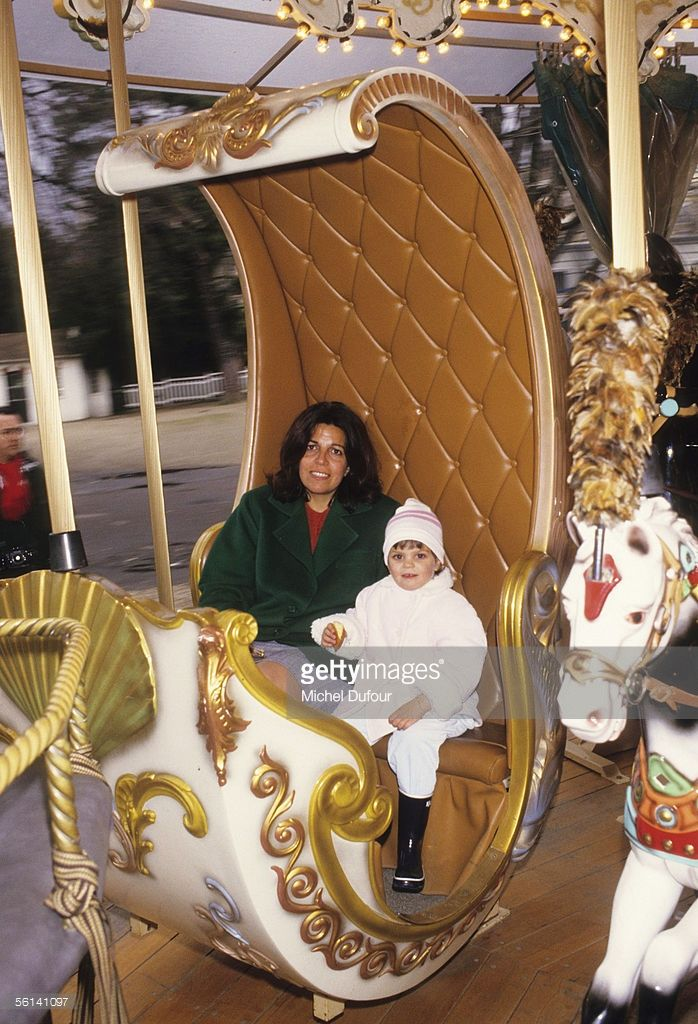 Christina Onassis, daughter of Greek shipping magnet Aristotle Onassis, enjoys a ride in the carousel with her daughter Athina, at Le Jardin d'Acclimation in Paris, France.