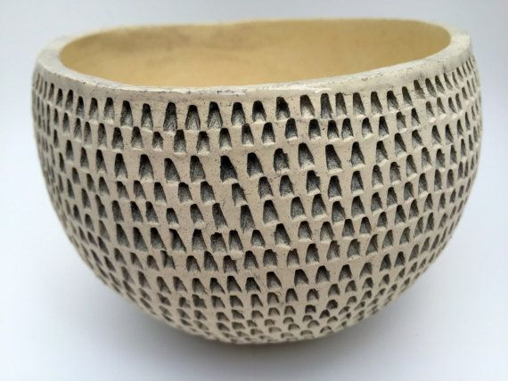 Organically designed hand-built earthenware bowl. This unique bowl has lovingly been textured by hand giving it that unique authentic hand built feel.