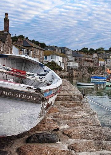 Mousehole, pronounced 'Mawzal', Cornwall, UK - Mousehole first appeared in the record books as a major fishing port in 1266.