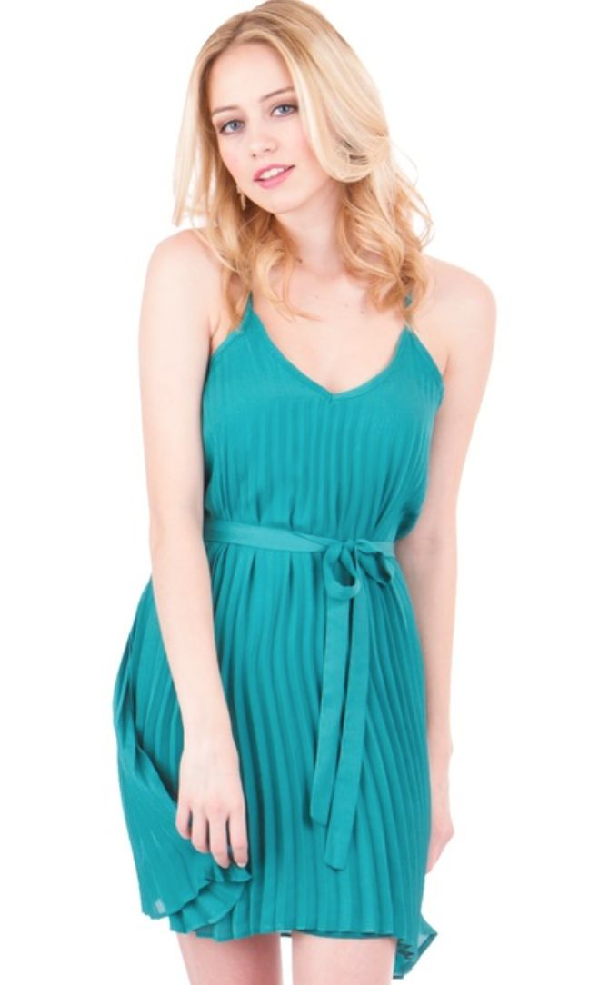 It's love at first sight for the Lilly dress! The Lilly dress should be part of every chapter's sorority recruitment. This pleated chiffon dress has a flattering v-neckline and a self tie sash to define the waist. Spaghetti straps allow the top to be easily adjusted.  http://greek.shoprevelry.com/lilly-dress/