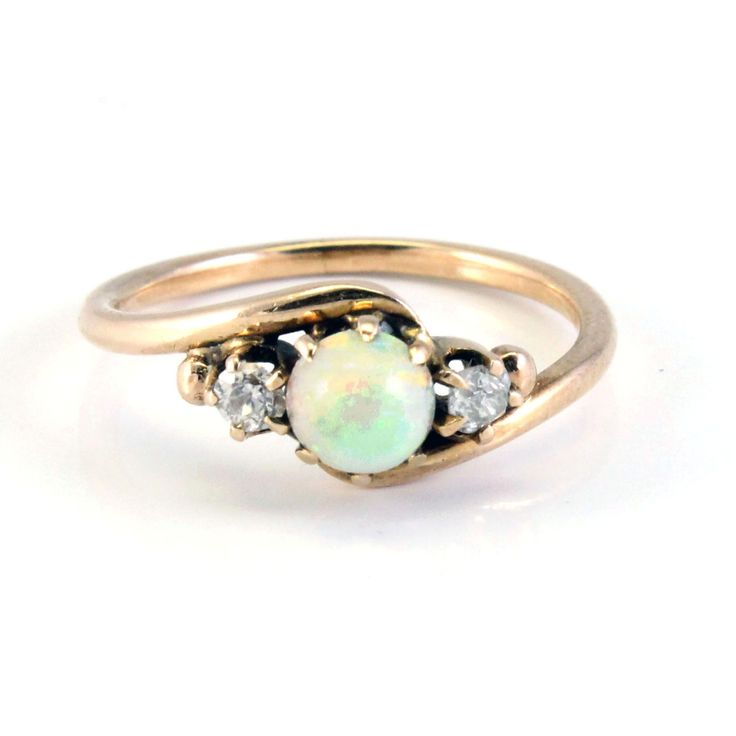 14K Antique Art Nouveau Gold Fire Opal and Diamond Ring. $428.00, via Etsy.
