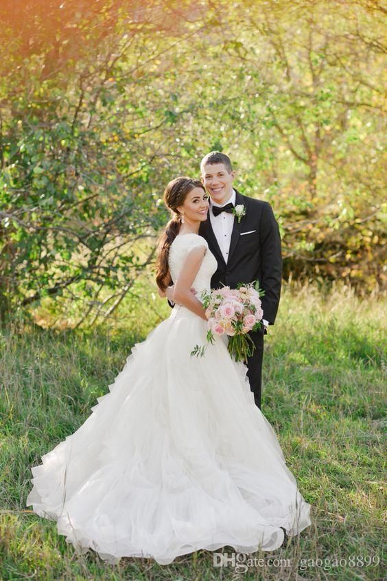 The 25 best country wedding gowns ideas on pinterest lace cheap modest cowboy boots country wedding dresses with cap sleeves 2016 v neck ruffles tiered skirt a line lace organza cheap wedding gowns as low as junglespirit Gallery