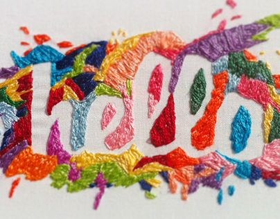 This embroidered lettering was crafted by hand using cotton thread on cotton fabric. The overall shape of the colour splash was done by freehand.