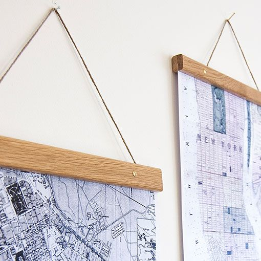 poster hanger - wood clamps with string - easy DIY and a great idea. put matching piece on bottom to weight the poster