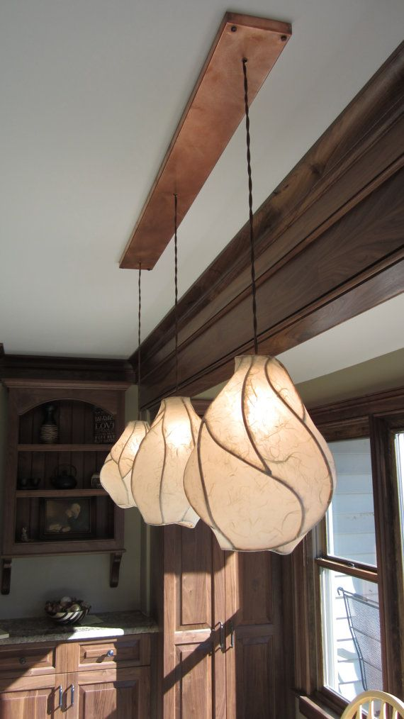 The Firefly Chandelier - A Khalima Lights original design! Our graceful Firefly Lanterns are grouped together on a handmade copper canopy to create a stunning chandelier like no other. Every piece of this chandelier is made by hand, with careful attention given to each detail. No two Firefly lights are alike, creating what seems to be a living, moving work of functional art.  Specs:  ~Copper Canopy~  - We handmake our copper canopies. Custom dimensions are no problem for us. Please contact…