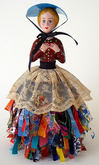 Prairie Girl by nancy wiedower. The top part came from an old pin cushion. Skirt made of wire with tied pieces of fabric on and added the lace. The hat is a piece of plastic. There was a lot of refurbishing and painting on the doll part.