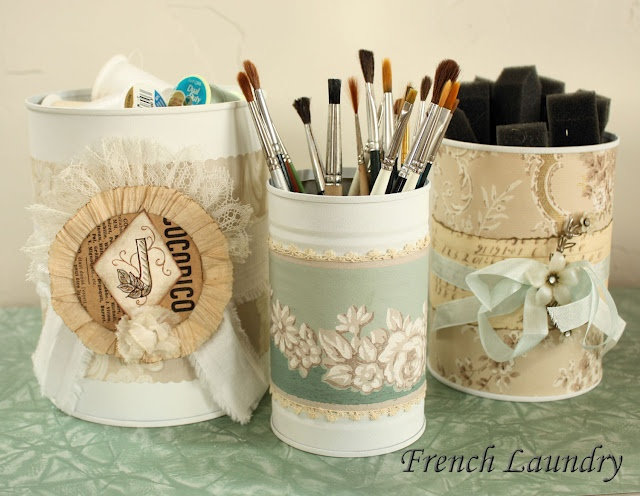 Coffee cans spray painted and covered with vintage wall paper