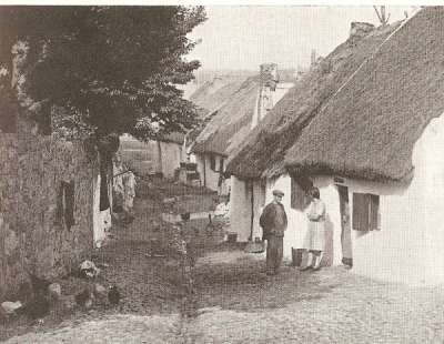 """The Claddagh, shortly before they were demolished, where the """"native"""" Irish lived...just outside the city walls of Galway where the """"elite"""" lived..."""