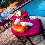 Suhaag Garden, Florida Indian wedding decorators, Trump International Beach Resort, poolside wedding, outdoor wedding, beach wedding, destination wedding, Mehndi, oceanfront, benches, throw pillows, mini umbrellas