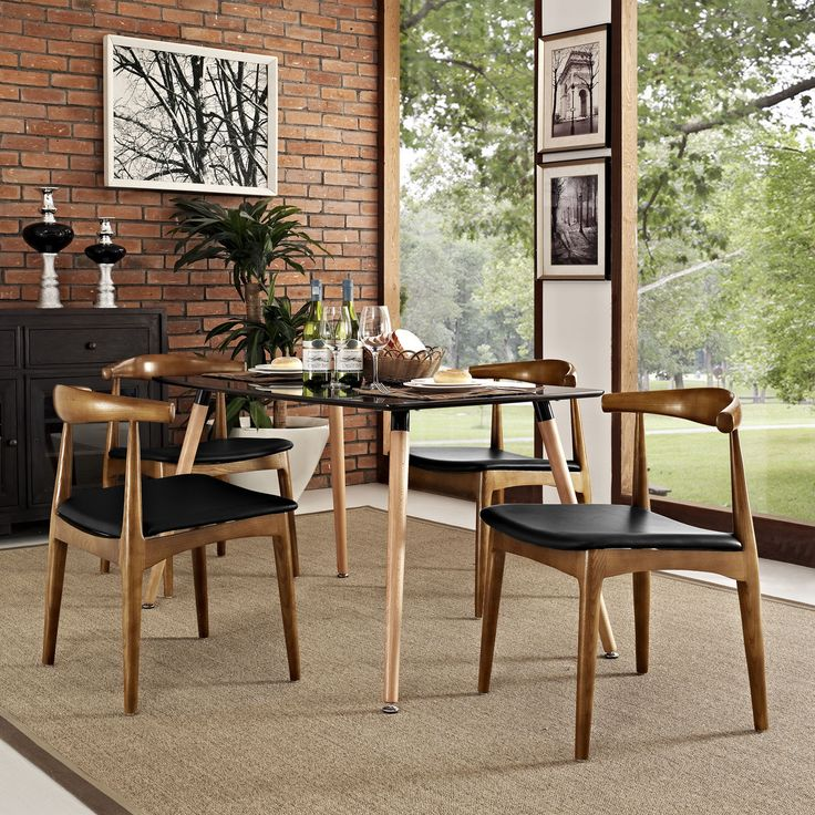 Embrace Mid Century Style With This Set Of Four Tracy Dining Chairs Crafted