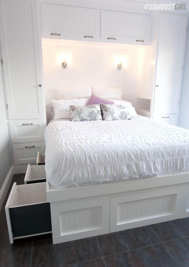 Wardrobes on either side with cut-out side to mimic side tables (I'd want a bigger space), wired in lamps