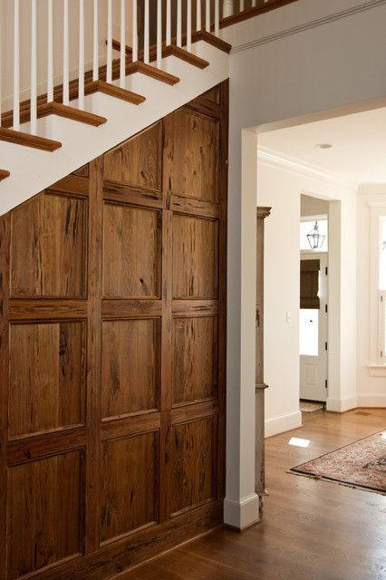 Family Room With Fireplace, Wood Paneling, Pecky Cypress Interior Doors, Storage Under Stairs