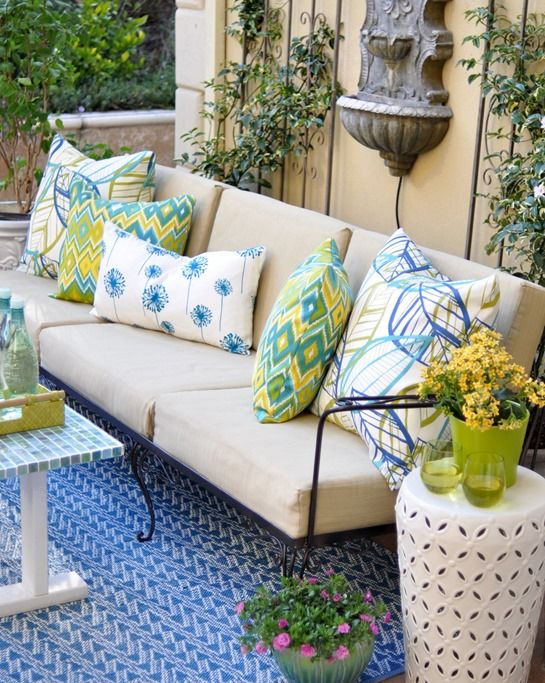 Love the colors of this outdoor patio - sofa is  covered with Sunbrella Dupione Maize fabric and pillows are made with Belize Botanical Azure, Marva Kiwi Splash, and Dandelion outdoor fabrics