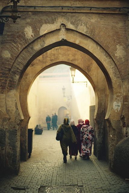 Thousands of years of history in this beautiful land. Moroccan women passing through an arched way. #Morocco #History #Arches.