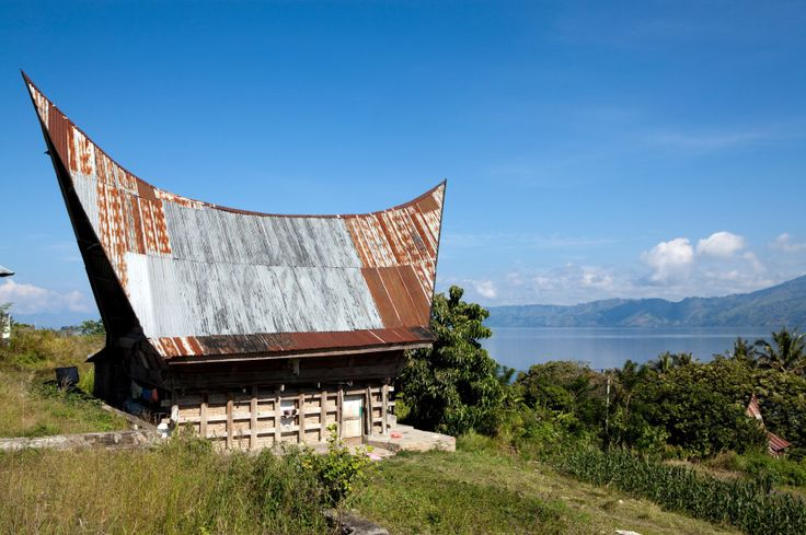 Traditional house of the Toba Batak People on Lake Toba in Sumatra, Indonesia. Lake Toba is also a supervolcano. See Toba Disaster Theory.
