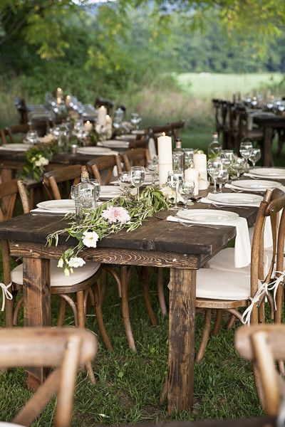 Rustic chic outdoor wedding reception idea - raw wood tables + floral table runners and white linens {Bolton-Reuter Photography}