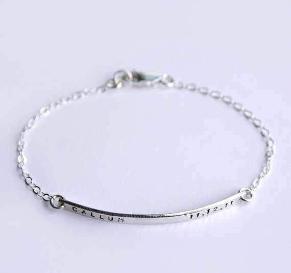 Our minimal, modern and beautifully made sterling silver name bar bracelet, is the perfect mom bracelet! Personalize the bar to never be far from the one you love with a name and date as shown, or personalize in your own way. We can hand stamp the bar with up to 14 characters on the front side, including: numerals, letters, the period mark, an ampersand, a hashtag, and heart. (Back stamping is available by special request). We use a heavy gauge metal to create all our nameplates which gives…